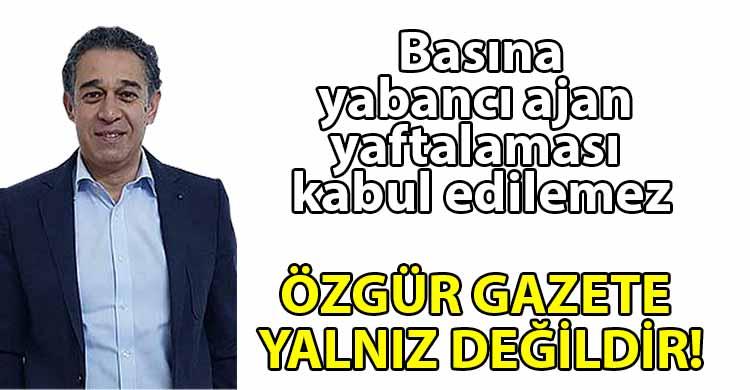 ozgur_gazete_kibris_Asiksoy_Ozgur_basinin_yanindayiz