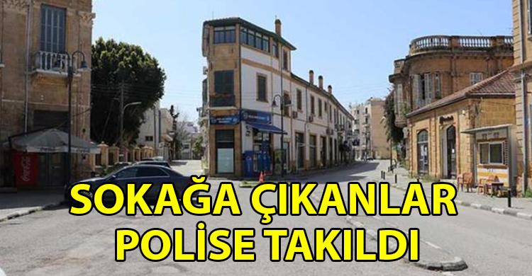 ozgur_gazete_kibris_Sokaga_cikma_yasagini_ihlal_ettiler